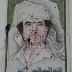 Gaddafi mural with bullet holes by mojomogwai, on Flickr