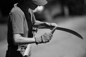 Scythe being sharpened