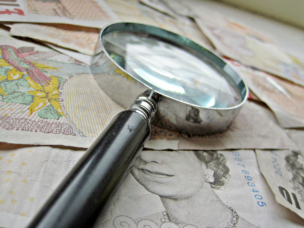 costs assessment money magnifying glass