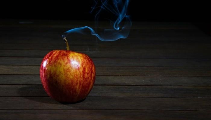 smoking apple candle