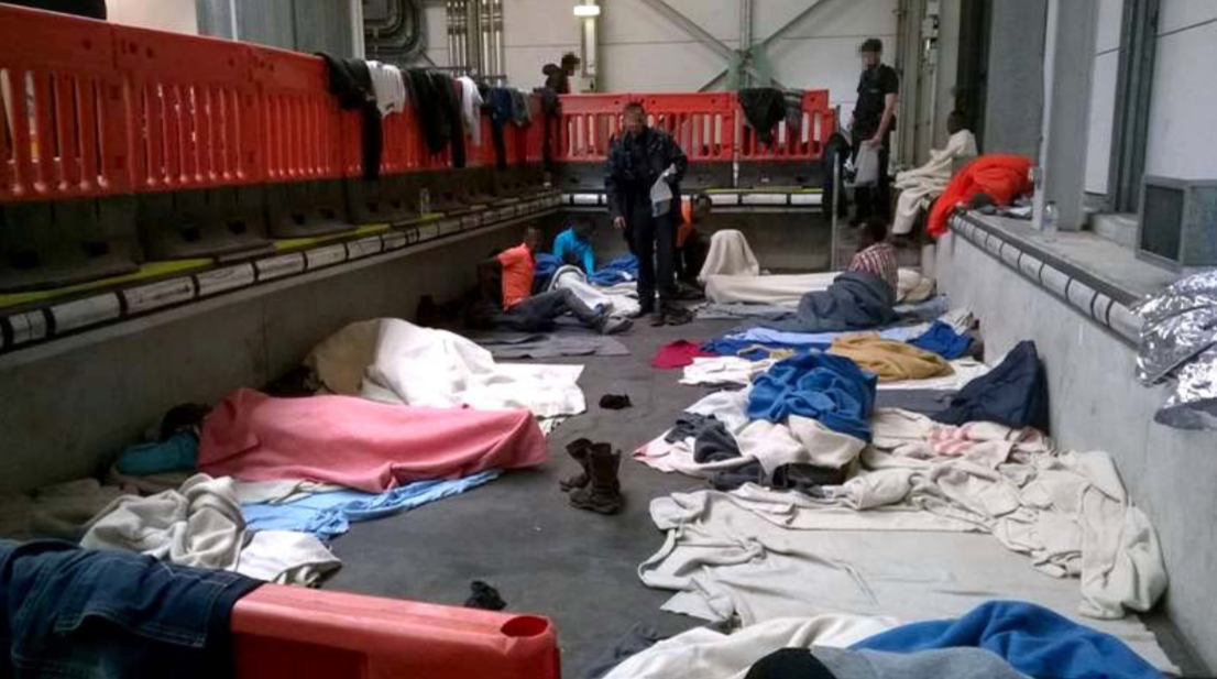 "Inspectors: Refugees held in ""wholly unacceptable"" conditions in freight shed"