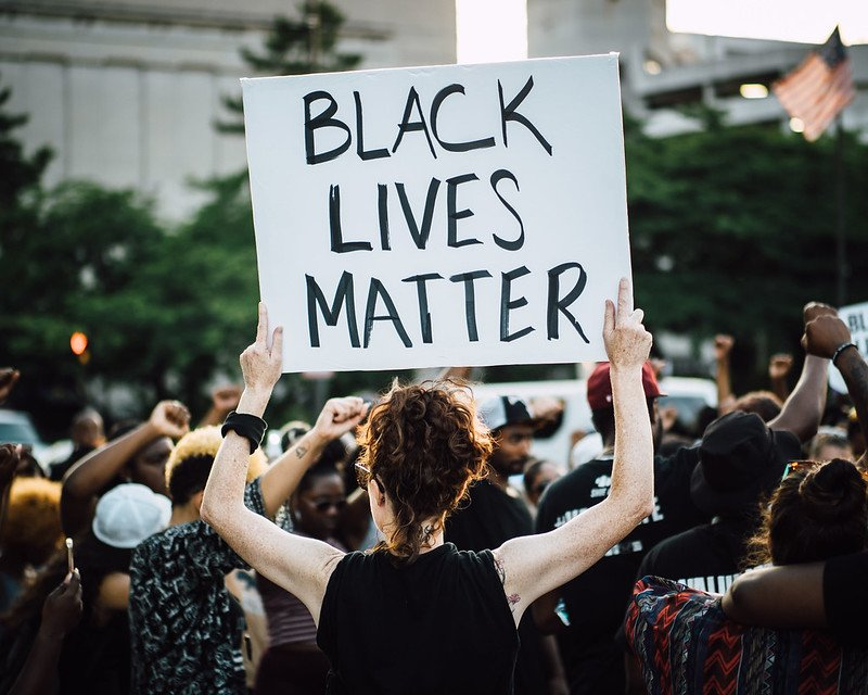 Comment: being non-racist is not enough
